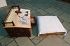 """Writing desk  (Pic 264 2nd year - 09 Oct 2009)<br /> Leica Digilux-4 - no crop or PP <br /> <br /> Shot at an exhibition of 'painting on furniture' by Manish Joshi in Ahmedabad on 2nd October 2009 (Gandhi Jayanti - Mahatma Gandhi's birth <br /> anniversary). <br /> Mahatma Gandhi used such a desk for his work.<br /> <br /> NOTE: Such desks were quite common in the earlier days when people did not use desk (table) & chairs.  People used to sit on thick mattresses and use such desks for writing.  In my old office we had a room with a similar setup! <br /> <br /> more pics <br />  <a href=""""http://hershy.smugmug.com/Travel/Ahmedabad/October-2009/9859810_e7xxy/1/669546611_MS3Ph"""">http://hershy.smugmug.com/Travel/Ahmedabad/October-2009/9859810_e7xxy/1/669546611_MS3Ph</a><br /> <br /> <br /> """"Strength does not come from physical capacity. It comes from an indomitable will.""""<br /> Mahatma Gandhi<br /> <br /> <br />  <a href=""""http://www.javeri.net"""">http://www.javeri.net</a>"""