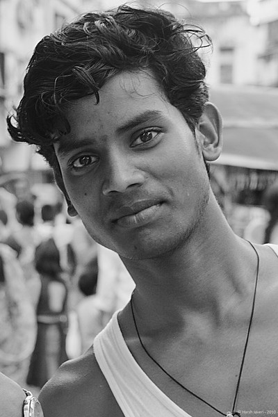 "Ready to pose<br /> 11 July 2010<br /> <br /> This is cropped from a shot with three guys who were 'posing' for my friend. That and other pics are at <br /> <br /> <a href=""http://hershy.smugmug.com/Photography/Mumbai-my-city/Misc-shots-of-Mumbai/6410100_x8urE#927521927_tHmQU"">http://hershy.smugmug.com/Photography/Mumbai-my-city/Misc-shots-of-Mumbai/6410100_x8urE#927521927_tHmQU</a><br /> <br /> Shot at Colaba market in South Mumbai."