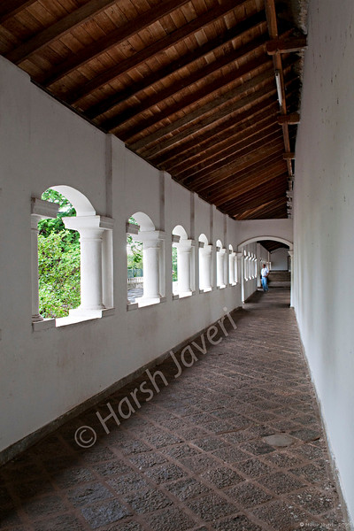 """Corridor (Pic 189 2nd year)<br /> <br /> This is the corridor that leads to the five caves of Dambulla rock temple. <br /> <br /> The rock towers 160 m over the surrounding plains.There are more than 80 documented caves in the surrounding area. Major attractions are spread over 5 caves, which contain statues and paintings related to Lord Buddha and his life. There are total of 153 Buddha statues, 3 statues of Sri Lankan kings and 4 statues of gods and goddesses. <br /> <br />  <a href=""""http://en.wikipedia.org/wiki/Dambulla_cave_temple"""">http://en.wikipedia.org/wiki/Dambulla_cave_temple</a><br /> <br /> <br />  <a href=""""http://www.javeri.net"""">http://www.javeri.net</a>"""
