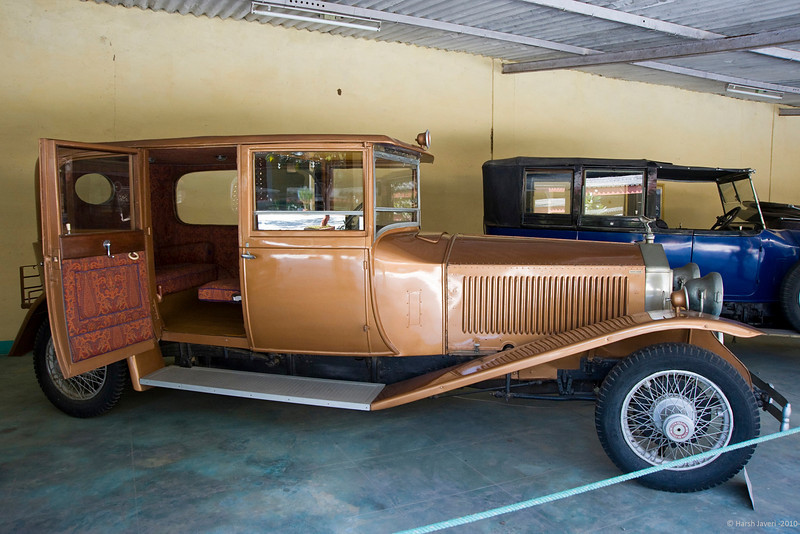 "Rolls Royce Phantom, England, 1927 (Jasdan state)<br /> The door pocket and the seats were covered with brocade. <br /> <br /> More car pictures at the gallery <a href=""http://hershy.smugmug.com/Travel/Auto-car/11122799_spyvi#779308632_mafby"">http://hershy.smugmug.com/Travel/Auto-car/11122799_spyvi#779308632_mafby</a><br /> <br /> Dastaan farm situated about 30 km outside Ahmedabad, is a splendid collection of vintage cars at the Auto World Vintage Car museum (Dastaan farm). Privately owned by Mr Pranlal Bhogilal, it has over 125 cars such as Rolls Royce, Bentley, Model T Ford, Jaguar, Chrysler, Mercedes, Fiat, Maybach, Packard, Cadillac, Buick and more... Founder-president of the Vintage and Classic Car Club of India, Mr Bhogilal may have the largest collection of vintage cars in the world. More than numbers, the important point is that all the cars have been restored to perfection and are in working order.<br /> <br /> The place also has a ethnic restaurant serving delicious Gujarati food making this an ideal place to spend a day with the family.<br /> <br /> Unfortunately time was short and I had to cover them in half an hour only! Luckily, as it's quite close to Ahmedabad, I hope to pay a leisurely visit soon<br /> <br /> more info:<br />  <a href=""http://wikimapia.org/2267077/Auto-World-Vintage-Car-Museum"">http://wikimapia.org/2267077/Auto-World-Vintage-Car-Museum</a><br />  <a href=""http://www.gujaratplus.com/news/Ahmedabad/28016.html"">http://www.gujaratplus.com/news/Ahmedabad/28016.html</a><br />  <a href=""http://www.houseofmg.com/tour_museums.php"">http://www.houseofmg.com/tour_museums.php</a><br />  <a href=""http://subodhsangwan.wordpress.com/2009/07/18/a-trip-down-the-memory-lane"">http://subodhsangwan.wordpress.com/2009/07/18/a-trip-down-the-memory-lane</a>…-vintage-cars-museum/<br /> <br /> <br />  <a href=""http://www.javeri.net"">http://www.javeri.net</a>"