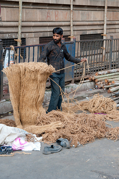 "Coir work (Pic 239 2nd year - 14 Sep 2009)<br /> <br /> Shot last month, the man was preparing the coir ropes for the 'mandaps'  (pavilions) for the Ganesh festival. <br /> <br />  <a href=""http://www.javeri.net"">http://www.javeri.net</a>"