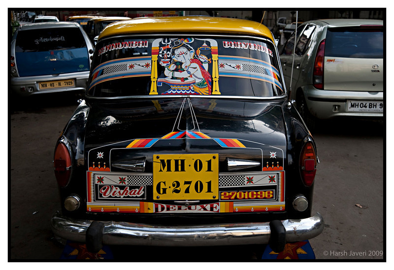 "Taxi! (Pic 245 2nd year - 20 Sep 2009)<br /> This OLD model Fiat comprised a major part of Indian cabs, but  now they are being phased out. Many of them have colourful decorations & names. The names vary: Vishal here may be his son's name. Certain taxis ply long distances and  here the two destinations are New Mumbai & Bhayandar. In the middle is Lord Ganesha's (considered auspicious) picture.<br /> <br />  <a href=""http://www.javeri.net"">http://www.javeri.net</a>"