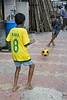 Football fever<br /> 05 July 2010 <br /> Colaba Market is situated very close to Nariman house which was used by the terrorists when they attacked Mumbai two years back.  Went there last Sunday with two friends for a photo shoot and saw these kids playing in a by lane. <br /> <br /> ==============<br /> It has happened again! I got one more comment from one EyeImage about commenting on 'old' pictures. It seems it's the same person as the words are identical... what's interesting is that the commenting person has used the names of members of Daily community!<br /> <br /> The two comments are: <br /> Eye Image: Don't mess up the pages by commenting all old pictures<br /> Murray: Don't mess up the pages by commenting all old pictures. Follow some discipline<br /> <br /> As mentioned earlier, due to work and other pressures I am not able to comment daily but do so every few days when I get the chance. This is the reason I make it a point to visit the daily galleries of the people and check out the last few entries and comment on the ones I like. I'd rather do this than miss out on good shots.  I doubt if this is against some discipline /rules as have found NEW COMMENTS on pictures over a year old... <br /> <br /> Views / suggestions welcome.