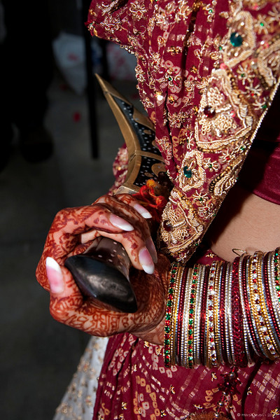 "Beware! <br /> 007 2nd year)<br /> <br /> Yes, that's a dagger she's holding! Another tradition where the bride keeps a dagger to keep the evil spirits away. <br /> No crop or PP <br /> <br /> <br />  <a href=""http://www.javeri.net"">http://www.javeri.net</a>"