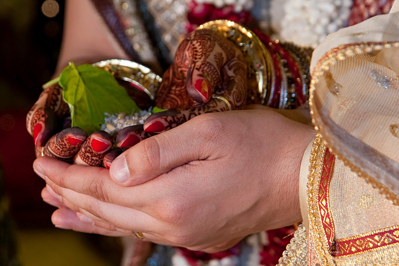 """United... (Pic 339 2nd year - 05 Jan 2010)<br /> <br /> The joining of hands by the bride and groom in a Hindu wedding is as symbolic as the exchange of rings in the Christian tradition.<br /> <br /> More pics at <br />  <a href=""""http://hershy.smugmug.com/Events/Parthiv-Neha/Wedding-SunnSand/10789542_aGGyq"""">http://hershy.smugmug.com/Events/Parthiv-Neha/Wedding-SunnSand/10789542_aGGyq</a><br />  <a href=""""http://www.javeri.net"""">http://www.javeri.net</a>"""
