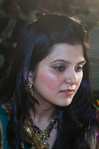 """Cousin (Pic 341 2nd year - 07 Jan 2010)<br /> <br /> This is bride Neha's cousin <br />  <a href=""""http://hershy.smugmug.com/gallery/6972999_iVPCh#758644879_rF6GZ"""">http://hershy.smugmug.com/gallery/6972999_iVPCh#758644879_rF6GZ</a><br /> <br /> The professional photographer shooting video had set his lights from 3-4 directions. I used one as 'against-the-light'  source and filled in with a reduced flash on camera.  I had to correct  colours because of the different kelvin of the video lights. <br /> <br /> <br /> More pics at <br />  <a href=""""http://hershy.smugmug.com/Events/Parthiv-Neha/Parthiv-Wedding-2/10845285_VJ5Zg#759963759_ajfCj"""">http://hershy.smugmug.com/Events/Parthiv-Neha/Parthiv-Wedding-2/10845285_VJ5Zg#759963759_ajfCj</a><br /> <br /> CHECK THIS OUT! <br /> Search SmugMug photos easily<br />  <a href=""""http://robertnyman.com/2009/03/26/search-smugmug-photos-easily-with-smug-search-ubiquity-command/"""">http://robertnyman.com/2009/03/26/search-smugmug-photos-easily-with-smug-search-ubiquity-command/</a><br /> meant mainly for Windows/ Fiefox users. <br /> <br />  <a href=""""http://www.javeri.net"""">http://www.javeri.net</a>"""