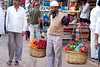 """Fresh!  (Pic 195 2nd year)<br /> <br /> This person was selling fresh carrots & radish in the market at Mahabaleshwar. It was a difficult shot as he would walk a few steps, stop & look for customers and again move on.  In addition there was a continuous flow of people walking by... <br /> <br />  <a href=""""http://www.javeri.net"""">http://www.javeri.net</a>"""