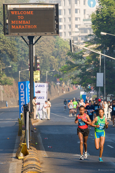 """4th year Pic 063 - Jan 19 2012 <span style=""""color:yellow"""">Mumbai Marathon 2012</span>  The Mumbai Marathon is an annual international road running competition over the marathon distance that is held in Mumbai, India, each January. First held in 2004, the Mumbai Marathon was part of """"The Greatest Race on Earth"""", an event sponsored by Standard Chartered Bank. The race has five separate race categories: Marathon Elite (professionals) (42.195 km),  Marathon open (42.195 km),  Half Marathon (21.097 km), Dream Run (7 km), Senior Citizens' Run (4.3 km) and Wheelchair (2.5 km)  The full and half marathons routes pass just round the corner from my house and shot some pics with friend Darshan on 15th January. The picture shows two Ethiopian professional female runners."""
