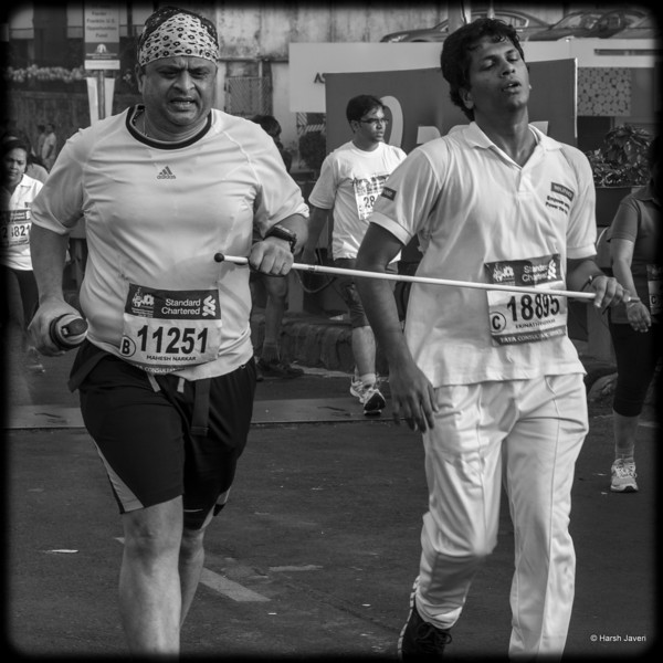 "4th year Pic 306 - Jan - 30 2013. <span style=""color:yellow"">Where there's a will...  </span> -  Mumbai Marathon 2013, Mumbai  This visually impaired man was doing the half marathon of 21.1 kms.  <span style=""color:cyan"">Critiques welcome! BEST VIEWED in large size. </span>"