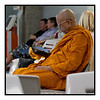"4th year Pic 136 - May - 17 2012 <span style=""color:yellow"">Keeping up to date </span> - Bangkok airport  I noticed this Buddhist monk going thru his iPad while waiting to board a flight at Bangkok airport.   Hi everyone! Got back last week from a nice holiday to Bangkok & Chiang Mai. Was busy with work and also feeling a bit lazy getting back to the Daily till Papa (Dennis Hoffman) & Susan Giman prodded me at FB yesterday!  Was told that the Thumbs-Up / Down is finally removed from the Daily gallery? Hope all you guys are fine. Will try and catch up with all the great pics that make up the Daily gallery!  I sold my Nikon D700 body a few days after the announcement of D800 and was waiting for the new body but apparently there is a world wide shortage of the new models! This is the first time in over thirty years that I am without a Nikon and hence took Olympus E-P3 and Leica V-20 (my friend insisted I take his for long tele-shots and compact size) on this trip.  <span style=""color:cyan"">For RuSu </span>. Yes I read about the old Leica sale. There's a special edition of the latest model M9-P made for Hermes which costs, with one lens, $25000! :)"