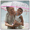 "4th year Pic 163 - June - 21 2012 <span style=""color:yellow"">First rains </span> - 10 June 2012 Anika had her first feel of the rains with her great aunt Urvashi (my sister)!"
