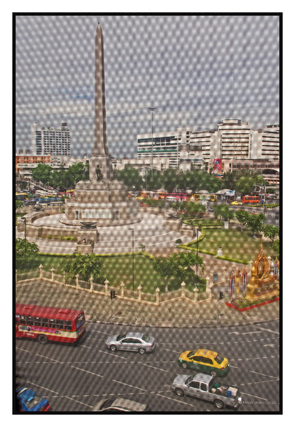"4th year Pic 188 - July - 30 2012 <span style=""color:yellow""> Victory monument</span>, Bangkok, Thailand  This was shot from BTS Skytrain with 24mm on Olympus E-P3. The 'texture' is from the reinforced glass of the train and thought it gave a nice affect."