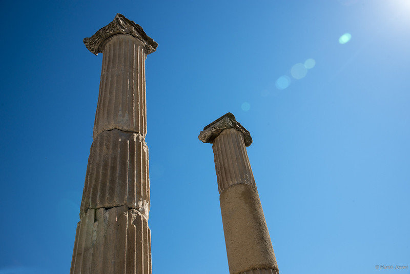 "4th year Pic 225 - Oct - 02 2012. <span style=""color:yellow"">Sun lit... </span>- Ephesus, Turkey <span style=""color:cyan"">Critiques welcome!</span> I liked how the light created the flare... B&W white is here  http://hershy.smugmug.com/Travel/Turkey/Ephesus/25565177_VmXcHn#!i=2118637063&k=h7Wqscv&lb=1&s=A  Ephesus was an ancient Greek city, and later a major Roman city, on the west coast of Asia Minor, near present-day Selçuk, Izmir Province, Turkey. It was one of the twelve cities of the Ionian League during the Classical Greek era. In the Roman period and had a population of more than 250,000 in the 1st century BC. The city was famed for the Temple of Artemis (completed around 550 BC), one of the Seven Wonders of the Ancient World. Emperor Constantine I rebuilt much of the city and erected new public baths.   http://en.wikipedia.org/wiki/Ephesus"
