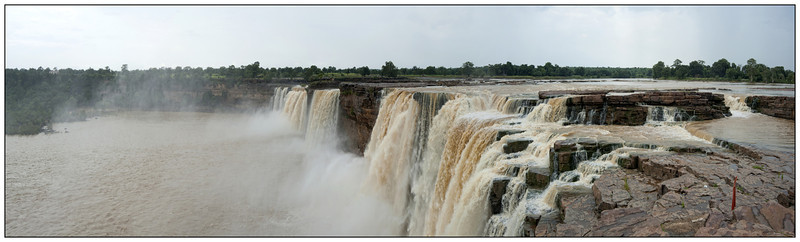 "4th year Pic 021 - Nov 22 2011 <span style=""color:yellow"">Chitrakoot waterfalls</span> Pano from 10 images  <span style=""color:red"">Best viewed in XLarge size</span> Chitrakoot Falls, also called Niagara falls of India; are located 38 km (24 mi) from Jagdalpur in state of Chitrakoot which also happens to a religious pilgrimage of Hindus. River Indravati falls from a height of 29 m (96 ft) to form this waterfall and it widens upto 150 meters (492 ft) during monsoon and thta's why they are also known as the Niagara falls of India. The shape of the waterfall is like a horse-shoe and the water color changes from season to season. In monsoon because of silt it turns a little brown in shade whereas in summer it's white and clear.  Another pano shot and other shots are here: <br> http://hershy.smugmug.com/Travel/Chitrakoot-waterfalls/18610549_kXkHFK#1447671854_nBDS6Sz"