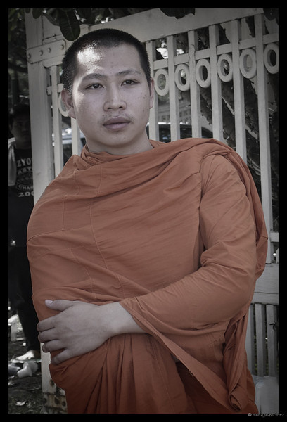 """4th year Pic 171 - July - 7 2012 <span style=""""color:yellow"""">Young monk</span>, Chinag Mai, Thailand  My friend Shishir saw the original version of this pic and suggested that I try, """"Phil Borges look. coloured but not complete desaturated. More desaturated everywhere but the Monk, the monk to be a little less desaturated.""""  NOT AGAIN! The SNAKE is up to it's dirty tricks again!!! This picture, after Keyphoto's comment; was Thumbed down out of the gallery!"""