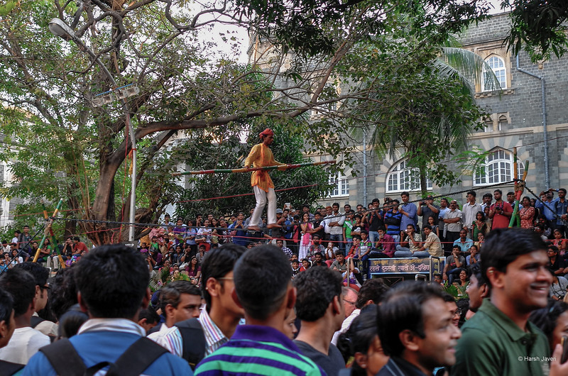 "4th year Pic 337- Apr - 16 2013. <span style=""color:yellow"">Tight rope walk  </span> -  Kala Ghoda festival, Mumbai <span style=""color:cyan"">Critiques welcome!  Best viewed in large size! </span>  Don't know about others but my pictures are still targeted regularly. Yesterday's shot was pushed WAY below others with FAR less comments. On top of that, some MORON has commented, ""Hershy & Dubin are the same person - called mulitple accounts under fake names"" !! http://smu.gs/YZnVjU    [Dublin:  Arnold Dublin] HOW STUPID / ENVIOUS can a person get??"