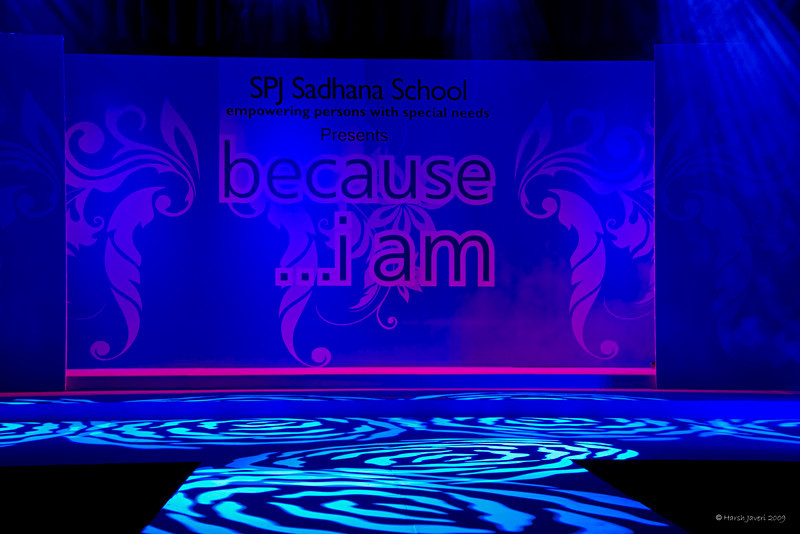 """315 - Apr 02<br /> Because I am <br /> D300 ISO 800 f5.6 1/13<br /> <br /> Daughter Vinati's old school, SPJ Sadhana School for handicapped children, held a fashion show in March this year and had invited me to cover the event.  Famous designer-artist Hemant Trivedi worked with the mentally challenged children and created a spectacular show - third such show in recent years. The Arts dept. children worked on fabrics with painting, embroidery, embellishments. The fabrics were used to make dresses for the top models of the city who walked the ramp that day. It was not just models, in certain segments children from the school also accompanied the models. They were greeted with thunderous applause, not because they were 'special' children but because they deserved it - for their creativity & for walking the ramp so professionally. <br /> <br /> This was shot just before the show started and flash was not used to maintain the mood.<br /> <br /> <br /> more shots at <br />  <a href=""""http://hershy.smugmug.com/gallery/7780533_EjuBf/1/503485416_xjU2D"""">http://hershy.smugmug.com/gallery/7780533_EjuBf/1/503485416_xjU2D</a><br /> <br /> <br /> <br />  <a href=""""http://www.javeri.net"""">http://www.javeri.net</a>"""