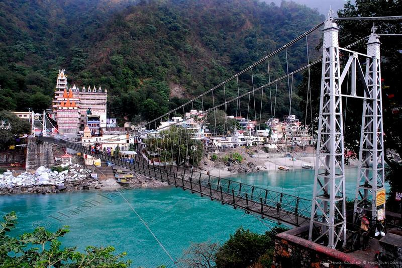 "Lakshman Jhula (Bridge) - Rishikesh<br /> <br /> Himalayas, Ganges, Pilgrimage, Spa, Rafting, Ayurvedic Treatment, Yoga, Meditation, Nature, Camping.... if there is one word for all these, it's ""Rishikesh""!<br /> <br /> About Rishikesh<br /> Rishikesh - known as the ""City of the Divine""- is a spiritual center to which sages, rishis, saints and pilgrims have flocked for millennia. The roads of the city are lined with bustling market places of ethnic arts and handicrafts, fresh produce markets, holy shrines and orange -robed sadhus (priests). Then, the road narrows, the markets become more sparse and you come upon a foot bridge, suspended high over the sacred Ganga (Ganges) river. As you cross this bridge, the sun streaming through the Himalayas to warm your being, you will feel as if you have truly come home. It is no surprise that pilgrims are drawn here from all over the world. The awe-inspiring beauty of the place, the clear, flowing Ganga, the majestic mountains, and the lush green forests will embrace and rejuvenate your entire being. <br /> <br /> Glass House on Ganges  <br />  <a href=""http://www.neemranahotels.com/glasshouse/index.html.htm"">http://www.neemranahotels.com/glasshouse/index.html.htm</a><br /> <br /> Rishikesh, Wikipedia  <br />  <a href=""http://en.wikipedia.org/wiki/Rishikesh"">http://en.wikipedia.org/wiki/Rishikesh</a><br /> <br /> Rishikesh, the land of Gods  <br />  <a href=""http://www.rishikesh.in/"">http://www.rishikesh.in/</a><br /> <br /> World renowned Ganga aarti at sunset  <br />  <a href=""http://parmarth.com/"">http://parmarth.com/</a><br /> <br /> Thanks to Roopal for the commentary & details"