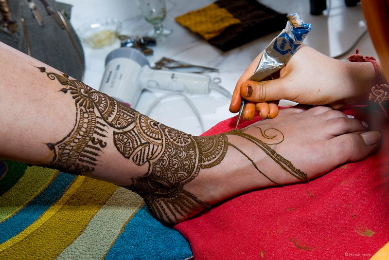 """Mehendi application<br /> After application, the paste is allowed to dry for 2-3 hours and then scraped off. The design comes up in a shade of brownish orange and the tone depends on the individual's body heat. The color takes on a deeper tone if kept for a longer time. <br /> <br /> <br /> for more details on Mehendi  <a href=""""http://en.wikipedia.org/wiki/Mehndi"""">http://en.wikipedia.org/wiki/Mehndi</a><br /> <br /> Rick, thanks for picking this pic! And don't worry, that's not a Tattoo pin, it's the nozzle of a tube! :-)<br /> <br />  <a href=""""http://www.javeri.net"""">http://www.javeri.net</a>"""