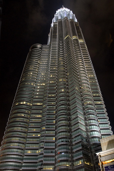 """180 24th Oct<br /> Petronas Towers <br /> <br /> Kuala Lumpur, Malaysia <br /> Shot hand held with D200 & 18-70mm. No PP. <br /> <br /> The Petronas Twin Towers (also known as the Petronas Towers or Twin Towers), in Kuala Lumpur, Malaysia were the world's tallest buildings, before being surpassed by the Taipei 101. However, the towers are still the tallest twin buildings and office building in the world. <br /> <br />  <a href=""""http://en.wikipedia.org/wiki/Petronas_Twin_Towers"""">http://en.wikipedia.org/wiki/Petronas_Twin_Towers</a><br /> <br />  <a href=""""http://www.javeri.net"""">http://www.javeri.net</a>"""