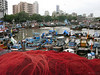 """Sassoon Docks<br /> <br /> Would you believe this was my first trip there? Thanks to my friend Sharookh for taking me there. It's a BUSY place and so colorful you don't know what NOT to shoot! This was evening time when people are busy preparing to sail next day. Morning is when they return with the catch and is another sight all together. Will visit there soon as am feeling better. <br /> <br /> The Sassoon Docks is one of the few docks open to the public in Mumbai, India. It was built by David Sassoon, a Baghdadi Jew. The docks is the main fish loading and trading centre in South Mumbai.<br />  <a href=""""http://en.wikipedia.org/wiki/Sassoon_Docks"""">http://en.wikipedia.org/wiki/Sassoon_Docks</a><br /> <br /> Leica shots are jpg files with no PP except for a bit of a crop and light adjustments in few pictures."""
