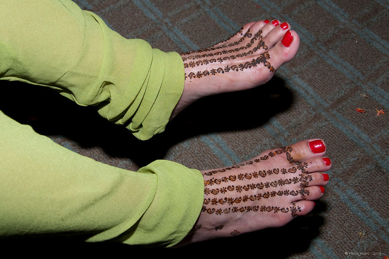 "354 <br /> Mehendi on feet <br /> D300 ISO 400 f8 1/125 18-105mm lens<br /> <br /> Grandniece Romita had Mehendi put on her feet a day before her wedding. Mehendi is paste from Henna and applied on hands & feet on special occasions.  Once it's completely dry, it's washed off and the colour remains for a few days. <br /> <br /> for more info on Mehendi <br /> <br />  <a href=""http://en.wikipedia.org/wiki/Mehndi"">http://en.wikipedia.org/wiki/Mehndi</a><br /> <br /> more mehendi pics are at<br /> <br />  <a href=""http://hershy.smugmug.com/gallery/6972999_iVPCh/1/472296672_YcRWN/Large"">http://hershy.smugmug.com/gallery/6972999_iVPCh/1/472296672_YcRWN/Large</a><br /> <br />  <a href=""http://hershy.smugmug.com/gallery/6972999_iVPCh/1/472352089_9WLG7/Large"">http://hershy.smugmug.com/gallery/6972999_iVPCh/1/472352089_9WLG7/Large</a><br /> <br />  <a href=""http://hershy.smugmug.com/gallery/4836391_ACj8A/1/308722553_Ecqtx/Large"">http://hershy.smugmug.com/gallery/4836391_ACj8A/1/308722553_Ecqtx/Large</a><br /> <br />  <a href=""http://hershy.smugmug.com/gallery/4836391_ACj8A/1/270314185_g8p5k/Large"">http://hershy.smugmug.com/gallery/4836391_ACj8A/1/270314185_g8p5k/Large</a><br /> <br /> <br /> === Health note ===<br /> The back is better but not 100% good enough for me to sit for long periods which is a pain as I am missing out on the Daily offerings and the huge pile of pending shots is not getting less!<br /> <br /> <br />  <a href=""http://www.javeri.net"">http://www.javeri.net</a>"
