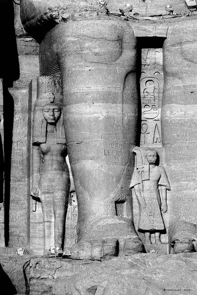 """Abu Simbel, Egypt<br /> <br /> Besides the Pyramids, a must-see in Egypt are the temples of Abu Simbel, situated 280 km from Aswan. The two temples built by Ramesses II are dedicated to Re-Harakhte, and that of his wife, Nefertari dedicated to Hathor. Built 3000 years ago, they were discovered by J. L. Burckhardt in 1813.<br /> <br /> The statues rise to 67 feet and are a majestic sight but the site is also famous for another reason. The original temples were built in a valley that was going to be submerged in Lake Naser with the waters from the new High Dam. In 1964 the Egyptian Govt., with the support of UNSECO shifted the temples, stone by stone; to the present site and took four years to complete.<br /> <br /> Turned to B&W<br /> <br /> <br /> <br /> More pictures in Abu Simble gallery:<br /> <br />  <a href=""""http://Hershy.smugmug.com/gallery/5455834_TMkdR/1/334512218_zscvq"""">http://Hershy.smugmug.com/gallery/5455834_TMkdR/1/334512218_zscvq</a><br /> <br /> More details can be found at<br /> <br />  <a href=""""http://www.touregypt.net/abusimbel.htm"""">http://www.touregypt.net/abusimbel.htm</a><br /> <br />  <a href=""""http://www.touregypt.net/featurestories/abusimbel.htm"""">http://www.touregypt.net/featurestories/abusimbel.htm</a><br /> <br /> <br />  <a href=""""http://www.javeri.net"""">http://www.javeri.net</a>"""