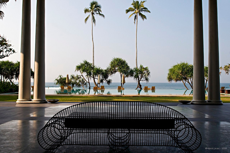 "239 - Jan 19<br /> View from the main lounge <br /> <br /> D300 17-55mm ISO 200 f8 1/500<br /> <br /> Our first stop in Sri Lanka was Galle, the southern beach town. We stayed at the Fortress, an exquisite hotel with a fortress type of a facade. The architecture inside had Dutch and Portuguese styles. Situated next to the blue waters of the Indian Ocean it had a lot of open space and the rooms were also very spacious. A gym, a spa, a swimming pool over looking the sea and lush greenery made this a perfect place to relax after a day around the city.<br /> <br /> <br /> more info:<br /> <br />  <a href=""http://www.thefortress.lk/index.html"">http://www.thefortress.lk/index.html</a><br /> <br /> <br />  <a href=""http://www.javeri.net"">http://www.javeri.net</a>"