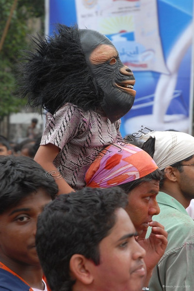 """356 <br /> Mask <br /> <br /> This is an old shot taken during Ganpati Visarjan.  The boy with the mask had a grand view beside being viewed himself!!<br /> <br /> For more info and pics check: <br /> <br />  <a href=""""http://hershy.smugmug.com/gallery/4836391_ACj8A/1/373773796_tmUCN/Large"""">http://hershy.smugmug.com/gallery/4836391_ACj8A/1/373773796_tmUCN/Large</a><br /> <br />  <a href=""""http://hershy.smugmug.com/gallery/4836391_ACj8A/1/386099995_CvmTG/Large"""">http://hershy.smugmug.com/gallery/4836391_ACj8A/1/386099995_CvmTG/Large</a><br /> <br />  <a href=""""http://hershy.smugmug.com/gallery/4836391_ACj8A/1/373761077_rPJ6W/Large"""">http://hershy.smugmug.com/gallery/4836391_ACj8A/1/373761077_rPJ6W/Large</a><br /> <br />  <a href=""""http://hershy.smugmug.com/gallery/4836391_ACj8A/1/373954136_mU7va/Large"""">http://hershy.smugmug.com/gallery/4836391_ACj8A/1/373954136_mU7va/Large</a><br /> <br /> <br />  <a href=""""http://www.javeri.net"""">http://www.javeri.net</a>"""