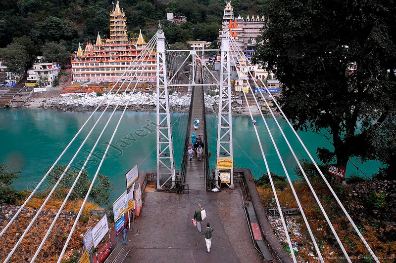 "157 1st Oct<br /> Lakshman Jhula (Bridge) - Rishikesh<br /> <br /> Shot with D200 18-70mm<br /> <br /> Rishikesh is a photographer's delight but unfortunately we had a very brief stop there on way to Kanatal from Glass House on Ganges. To add to my woes, there was a slight but continuous drizzle and I did not have an umbrella! Still, I managed a few shots of the few people and the famous bridge.  <br /> <br /> Do see two more pictures in the original gallery: <br /> <br /> for closer view:  <br />  <a href=""http://hershy.smugmug.com/gallery/3725534_2Hasx/1/221089796_aeDWU/Large"">http://hershy.smugmug.com/gallery/3725534_2Hasx/1/221089796_aeDWU/Large</a><br /> <br /> for a vertical image:  <br />  <a href=""http://hershy.smugmug.com/gallery/3725534_2Hasx/1/221090020_3c8Fv/Large"">http://hershy.smugmug.com/gallery/3725534_2Hasx/1/221090020_3c8Fv/Large</a><br /> <br /> Glass House on Ganges:  <br />  <a href=""http://www.neemranahotels.com/glasshouse/index.html.htm"">http://www.neemranahotels.com/glasshouse/index.html.htm</a><br /> <br /> Rishikesh, Wikipedia:  <br />  <a href=""http://en.wikipedia.org/wiki/Rishikesh"">http://en.wikipedia.org/wiki/Rishikesh</a><br /> <br /> Rishikesh, the land of Gods:  <br />  <a href=""http://www.rishikesh.in/"">http://www.rishikesh.in/</a><br /> <br /> World renowned Ganga aarti at sunset:  <br />  <a href=""http://parmarth.com/"">http://parmarth.com/</a><br /> <br /> Thanks to Roopal for the commentary & details<br /> <br />  <a href=""http://www.javeri.net"">http://www.javeri.net</a>"