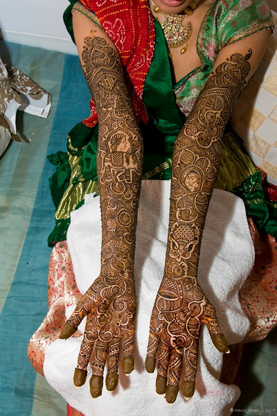 "Mehendi hands  (Best seen in Large or Original size) <br /> <br /> Beside geometrical figures & flowers, the design includes an Elephant and two human faces. At times the name of the groom is also written (hidden) which he has to find out later on! <br /> <br /> This kind of detailed design would take 3-5 hours (hands & legs)!<br /> <br /> for reference check the earlier two photos: <br /> <br />  <a href=""http://hershy.smugmug.com/gallery/4836391_ACj8A/1/271804178_q2CWc/Medium"">http://hershy.smugmug.com/gallery/4836391_ACj8A/1/271804178_q2CWc/Medium</a><br /> <br />  <a href=""http://hershy.smugmug.com/gallery/4836391_ACj8A/1/270314185_g8p5k/Medium"">http://hershy.smugmug.com/gallery/4836391_ACj8A/1/270314185_g8p5k/Medium</a><br /> <br /> for more info on Mehendi  <a href=""http://en.wikipedia.org/wiki/Mehndi"">http://en.wikipedia.org/wiki/Mehndi</a><br /> <br />  <a href=""http://www.javeri.net"">http://www.javeri.net</a>"