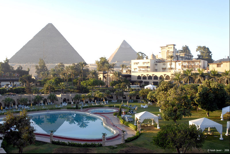 "Giza Pyramids. One of the wonders of the world. <br /> Cairo, Egypt.<br /> <br /> We had arrived late evening the day before and this was my first sight of the magnificent structure from our hotel Mena House, Oberoi. <br /> <br /> More pictures in gallery<br /> <br />  <a href=""http://Hershy.smugmug.com/gallery/2474371_PzaCC/1/129657266_BiaLK"">http://Hershy.smugmug.com/gallery/2474371_PzaCC/1/129657266_BiaLK</a><br /> <br /> Egypt info:  <a href=""http://www.touregypt.net/"">http://www.touregypt.net/</a><br /> <br />  <a href=""http://www.javeri.net"">http://www.javeri.net</a>"