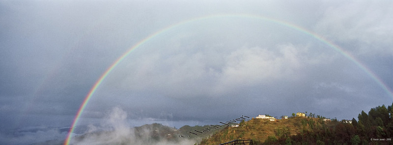 "Dual rainbows - Kanatal<br /> <br /> [Shot on Hasselblad XPan, a dual-format 35mm film camera also offering 24x65 (panorama) size. Best viewed at Original size.]<br /> <br /> After a wet and cold day the Sun presented us with TWO rainbows for a few minutes!<br /> <br /> Kanatal 35 kms from Mussoorie, is perched at an altitude of over 8,500 feet offering a spectacular view of the snow-clad Garhwal Himalayas and lush green forests. <br /> <br /> Mussoorie is located in the Garhwal hills in North India. Due to its immense natural beauty, Mussoorie is known as the queen of hill stations.<br /> <br /> <br /> for 35mm pictures  <a href=""http://www.smugmug.com/gallery/2340470/1/122842668"">http://www.smugmug.com/gallery/2340470/1/122842668</a><br /> <br />  <a href=""http://www.javeri.net"">http://www.javeri.net</a>"