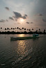 "362<br /> Sunset at Vembanad Lake<br /> <br /> At Kerala, hosts Daksha & Prem had organised boat rides for the guests on Vembanad Lake (Vembanad Kayal or Vembanad Kol), India's longest lake and also one of the largest lakes here. The Vembanad wetland system covers an area of over 1512 km and is approximately 14 kilometres wide at its widest point.. <br /> <br /> The ride was along the coast with a lot of greenery, something that Kerala is famous for. We also saw a couple of Houseboats on the way. With overcast sky the sunset was not a clear one. It was still scenic though!<br /> <br /> This shot is by son Jay. <br /> <br /> more pics of the boat ride: <br /> <br />  <a href=""http://hershy.smugmug.com/gallery/8427608_pjpHZ/1/552585360_oXzjV"">http://hershy.smugmug.com/gallery/8427608_pjpHZ/1/552585360_oXzjV</a><br /> <br /> more info: <br />  <a href=""http://en.wikipedia.org/wiki/Vembanad_Lake"">http://en.wikipedia.org/wiki/Vembanad_Lake</a><br /> <br />  <a href=""http://www.javeri.net"">http://www.javeri.net</a>"
