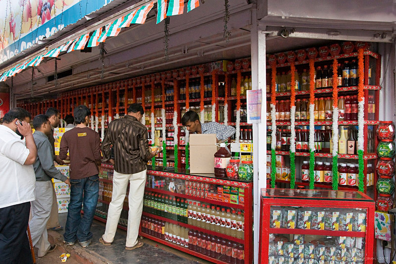 "300 - Mar 17<br /> Drink up! <br /> <br /> This small shop at Mahabaleshwar, a hill resort, was selling all types of squashes & juices. It was 27th January, a day after the Indian Republic day and the Orange, White & Green flower bands stood for the tri-color Indian flag. <br /> <br /> ==== NOTE ====<br /> Son Jay's wedding date is getting closer and we all are keeping very busy with the arrangements. Last 2-3 days were spent in getting the invitation cards ready. All this has kept me away from the Daily gallery so please excuse me if I am unable to comment on all the lovely entries. My loss entirely!  :( <br /> <br /> <br /> <br /> <br />  <a href=""http://www.javeri.net"">http://www.javeri.net</a>"