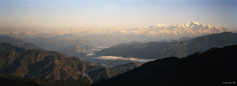 "Morning sun on Himalayas, Kanatal<br /> <br /> This is a SINGLE 35mm frame. Shot on Hasselblad XPan, a dual-format 35mm film camera, offering 24x35 & 24x65 (panorama) sizes. Best viewed at Original size.<br /> <br /> After a wet and cold day the morning sun gave us this breathtaking view of the mighty Himalayas. <br /> <br /> Kanatal 35 kms from Mussoorie, is perched at an altitude of over 8,500 feet offering a spectacular view of the snow-clad Garhwal Himalayas and lush green forests.<br /> <br /> Mussoorie is located in the Garhwal hills in North India. Due to its immense natural beauty, Mussoorie is known as the queen of hill stations.<br /> <br /> <br /> for 35mm pictures   <a href=""http://www.smugmug.com/gallery/2340470/1/122842668"">http://www.smugmug.com/gallery/2340470/1/122842668</a><br /> <br />  <a href=""http://www.javeri.net"">http://www.javeri.net</a>"