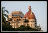 """213 22 Dec<br /> Back in action <br /> <br /> Shot last Sunday - D300 18-105mm f3.5-5.6 ISO 400, f8 1/250<br /> <br /> The Taj Mahal hotel was one of the main targets in the terrorist attacks in Mumbai which ended on 29th November after three horrifying days. This old icon of our city has 6 floors while the connecting new wing, The Tower is 22 story high. Work is going on to restore it to its old glory and heavy security keeps people away from the site. The picture shows the side with the damaged upper floors. At the back one can see the top floors of the new wing which had also sustained fires. <br /> <br /> Trident and the twin Oberoi hotels were also targeted and many people were shot dead in these hotels and they also sustained damage due to grenades and fires. <br /> <br /> Yesterday, in less than a month; The Taj Tower (new wing) and the Trident opened its gates to the public. There were emotional scenes and the mood was summed up by Tata Group chairman Ratan Tata when he said, """"She has stood for more than a 100 years and will stand for a 100 more. It was a challenge to have the hotel reopen in some form within a month of the attack. We may have been knocked down but will never be knocked out."""" <br /> <br /> More pictures of the Taj: <br />  <a href=""""http://hershy.smugmug.com/gallery/6410100_x8urE/1/440808583_txmYu"""">http://hershy.smugmug.com/gallery/6410100_x8urE/1/440808583_txmYu</a><br /> <br /> For full story: <br />  <a href=""""http://timesofindia.indiatimes.com/articleshow/3872067.cms"""">http://timesofindia.indiatimes.com/articleshow/3872067.cms</a><br /> <br />  <a href=""""http://www.javeri.net"""">http://www.javeri.net</a>"""