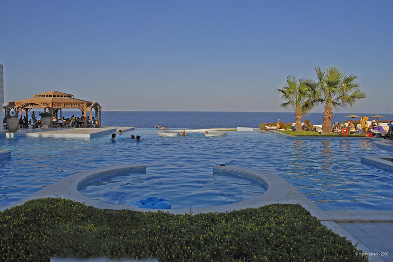 "Multi-level pool with sea in background at The Oberoi Sahl Hasheesh a luxury resort on the Red Sea coast in Hurghadha, Egypt. <br /> <br /> The blues are natural and not done up in PS! ;-) <br /> <br /> Spread over 48 acres, it's THE place to have a holiday! One can relax in the suite, enjoy the sun, the water... and forget all worries. The warm hospitality and delicious food adds to the experience.<br /> <br />  <a href=""http://www.oberoisahlhasheesh.com"">http://www.oberoisahlhasheesh.com</a><br /> <br />  <a href=""http://www.touregypt.net/"">http://www.touregypt.net/</a><br /> <br /> my site:  <a href=""http://www.javeri.net"">http://www.javeri.net</a>"