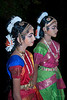 "352<br /> Bharatnatyam Dancers<br /> <br /> D300 ISO 400 f5.6 1/60 18-105mm lens<br /> <br /> The dinner following the engagement of Romita & Wilson had performances by local dancers.  Here two young dancers are awaiting their turn. <br /> <br /> Bharatanatyam is a classic dance form originating in Tamil Nadu, a state in Southern India and is also the National Dance of India. This dance form denotes various 19th and 20th century reconstructions of Cathir, the art of temple dancers. Cathir in turn, is derived from ancient dance forms. Bharatanatyam is usually accompanied by the classical Carnatic music.<br /> <br /> more details: <br />  <a href=""http://en.wikipedia.org/wiki/Bharat_Natyam"">http://en.wikipedia.org/wiki/Bharat_Natyam</a><br /> <br /> <br />  <a href=""http://www.javeri.net"">http://www.javeri.net</a>"