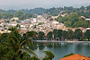 "228 Jan 06<br /> View of Kandy city <br /> D300 17-55mm ISO 400 f14 1/200<br /> <br /> In Sri Lanka, we made a short stop at Kandy en route from Galle to Tea Trails. Visited the Temple of Tooth and after a brief stroll had lunch at a restaurant overlooking the city.<br /> <br /> Kandy - a major tourist destination - is also known as the cultural capital of Sri Lanka. Nestled in the hills at an altitude of 488 m, it is located at a distance of 115 km from Colombo. A bustling commercial city, Kandy has a rich history. It was originally known as Senkadagala pura after a hermit named Senkada who lived there. Many of Sinhalese people call it Mahanuwara meaning the Great City. The name Kandy was derived by the colonial rulers from the word Kanda in Sinhala, meaning a hill.<br /> <br /> Today , Kandy is famous for the Kandy Perahara-a huge cultural pageant that takes place in the month of July or August. It is one of the most colorful processions of the world. Thousands of drummers and dancers accompanying a parade of ornamented elephants perform in the streets. The leading tusker carries the sacred tooth relic of Lord Buddha, while the spectators pay homage to it. The procession moves along the streets for seven consecutive nights and concludes on the day of the August full moon.<br /> <br /> The Temple of Tooth, also known as Dalda Maligawa, is one of the most sacred Buddhist pilgrimage sites in the world. Here, one of the Buddha's teeth is kept. The temple was built in the 17th century. A golden canopy has been added recently.<br /> <br /> There are many Buddhist temples surrounding Kandy and four Hindu shrines dedicated to Gods Vishnu and Natha and Goddess Patthini.<br /> <br /> More Kandy pictures at <br /> <br />  <a href=""http://hershy.smugmug.com/gallery/6950360_Soc9F/1/444816807_ygkxM"">http://hershy.smugmug.com/gallery/6950360_Soc9F/1/444816807_ygkxM</a><br /> <br />  <a href=""http://www.javeri.net"">http://www.javeri.net</a>"
