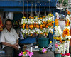 "Flowers stall, Babulnath, Mumbai <br /> Babulnath Temple, Mumbai<br /> <br /> Sunday shot. Doing a test run on Leica Digilux 2. Lovely camera with crisp details and perfect natural colors. Shot in jpg and no PP.<br /> <br /> Babulnath pictures <br />  <a href=""http://hershy.smugmug.com/gallery/5471259_eV2Qv"">http://hershy.smugmug.com/gallery/5471259_eV2Qv</a><br /> <br /> The temple was originally built in 1780 and a tall spire was added in 1900. It's in the heart of the city on a small hill at about 1000 ft. above sea level. <br /> <br />  <a href=""http://www.babulnath.com/"">http://www.babulnath.com/</a><br /> <br />  <a href=""http://www.javeri.net"">http://www.javeri.net</a>"