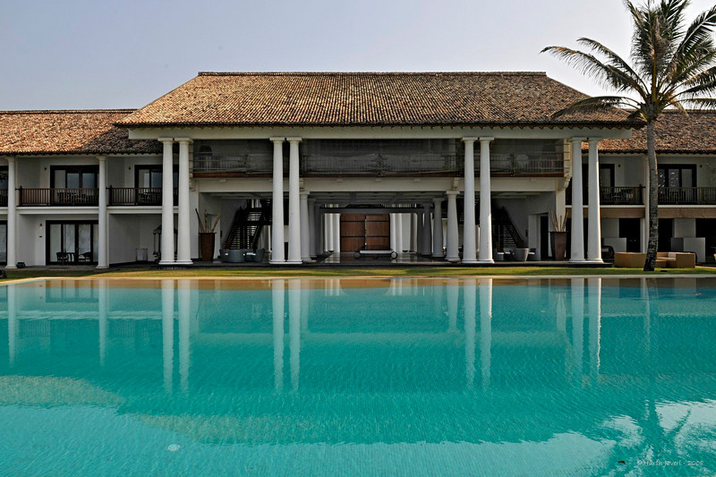 "240 - Jan 20<br /> Swimming pool <br /> <br /> D300 17-55mm ISO 200 f14 1/160<br /> <br /> Our first stop in Sri Lanka was Galle, the southern beach town. We stayed at the Fortress, an exquisite hotel with a fortress type of a facade. The architecture inside had Dutch and Portuguese styles. Situated next to the blue waters of the Indian Ocean it had a lot of open space and the rooms were also very spacious. A gym, a spa, a swimming pool over looking the sea and lush greenery made this a perfect place to relax after a day around the city.<br /> <br /> more pics: <br /> <br />  <a href=""http://hershy.smugmug.com/gallery/7035963_RG9it/1/456783652_BHMxG"">http://hershy.smugmug.com/gallery/7035963_RG9it/1/456783652_BHMxG</a><br /> <br /> more info:<br /> <br />  <a href=""http://www.thefortress.lk/index.html"">http://www.thefortress.lk/index.html</a><br /> <br /> ==== Answer to John UK ==== <br /> You are absolutely correct John! This was shot from the opposite side, near the two palms in that picture. <br /> <br /> ---- Sparky & Sam -----<br /> This was shot around 8 AM - when most of the people were still in their beds! :)<br /> <br />  <a href=""http://www.javeri.net"">http://www.javeri.net</a>"