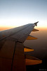 """289 - Mar 07<br /> Sunrise on way to Jaipur.  <br /> <br /> It was an early morning flight and midway the sun started coming up throwing this warm light on the wings. <br /> <br />  <a href=""""http://www.javeri.net"""">http://www.javeri.net</a>"""