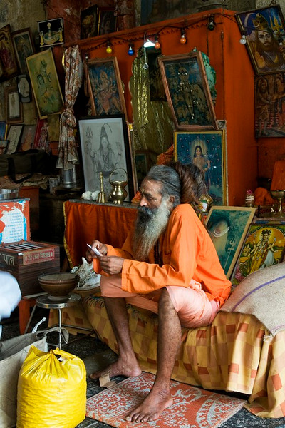 "A Sadhu (an ascetic)at Babulnath   <br />  <a href=""http://en.wikipedia.org/wiki/Sadhu"">http://en.wikipedia.org/wiki/Sadhu</a><br /> <br /> He has hair reaching the knees, unfortunately, it was tied up in a bun then! <br /> <br /> More Babulnath pictures   <br />  <a href=""http://hershy.smugmug.com/gallery/5471259_eV2Qv"">http://hershy.smugmug.com/gallery/5471259_eV2Qv</a><br /> <br /> The temple was originally built in 1780 and a tall spire was added in 1900. It's in the heart of the city on a small hill at about 1000 ft. above sea level. <br /> <br />  <a href=""http://www.babulnath.com/"">http://www.babulnath.com/</a><br /> <br /> <br /> <br />  <a href=""http://www.javeri.net"">http://www.javeri.net</a>"
