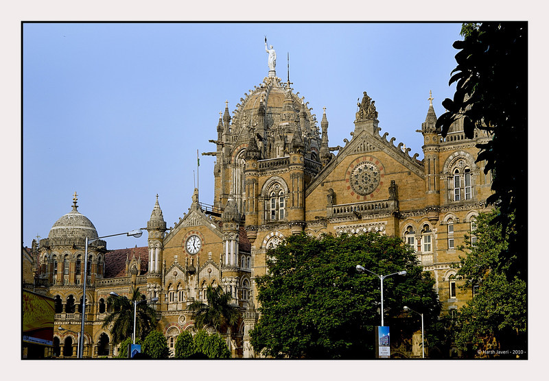 "3rd year Pic 112 - Nov 14 2010<br /> CST terminus<br /> <br /> Chhatrapati Shivaji Terminus, formerly Victoria Terminus, and better known by its abbreviation CST or Bombay VT, is a historic railway station in Mumbai which serves as the headquarters of the Central Railways. It is one of the busiest railway stations in India, and serves Central Railway trains terminating in Mumbai as well as the Mumbai Suburban Railway.<br /> <br /> The station was designed by Frederick William Stevens, a consulting architect in 1887-1888. The design bears some resemblance to the St Pancras railway station in London. The station building was designed in the Victorian Gothic style of architecture. The building exhibits a fusion of influences from Victorian Italianate Gothic Revival architecture and traditional Indian architecture. Internally, the wood carving, tiles, ornamental iron and brass railings, grills for the ticket offices, the balustrades for the grand staircases and other ornaments were the work of students at the Bombay School of Art. The station stands as an example of 19th century railway architectural marvels for its advanced structural and technical solutions.<br /> <br /> It took ten years to complete and was named ""Victoria Terminus"" in honour of the Queen and Empress Victoria.<br /> <br /> In 1996, in keeping with the policy of renaming locations with Indian names, the station was renamed by the state government after Chatrapati Shivaji, the famed 17th century Maratha king. On 2 July 2004, the station was nominated as a World Heritage Site by the World Heritage Committee of UNESCO.<br /> <br /> On 26 November 2008, two terrorists entered the passenger hall of the CST, opened fire and threw grenades at people. The terrorists were armed with AK-47 rifles. More than 50 people were killed in the attack.<br /> <br /> from <br />  <a href=""http://en.wikipedia.org/wiki/Chhatrapati_Shivaji_Terminus"">http://en.wikipedia.org/wiki/Chhatrapati_Shivaji_Terminus</a>"