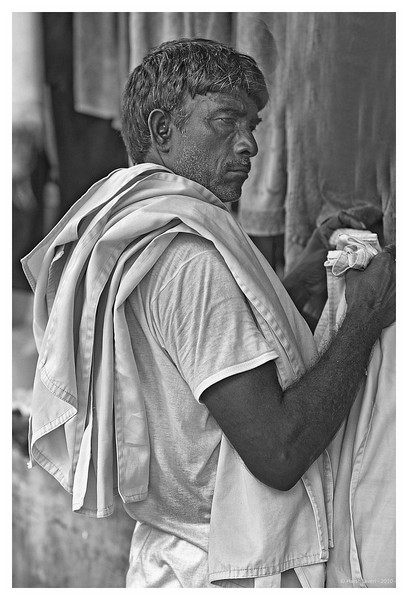 "3rd year Pic 044 - Sep 06 2010<br /> A Dhobi , Dhobi Ghat<br /> <br /> At Ahmedabad for few hours before I take the train for Mumbai. Once again, no time to comment , will catch up on return. <br /> <br /> Original colour version is here:    <br />  <a href=""http://hershy.smugmug.com/Photography/Mumbai-my-city/Dhobi-ghat-cuffe-Parade/10119943_4urML#986125021_bmXqM-A-LB"">http://hershy.smugmug.com/Photography/Mumbai-my-city/Dhobi-ghat-cuffe-Parade/10119943_4urML#986125021_bmXqM-A-LB</a>"