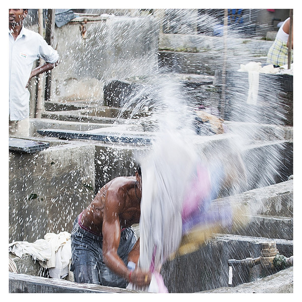 """3rd year Pic 042 - Sep 02 2010<br /> Splash! Dhobi Ghat<br /> <br /> B&W is here but I feel the splash of colour looks better:   <br />  <a href=""""http://hershy.smugmug.com/Photography/Mumbai-my-city/Dhobi-ghat-cuffe-Parade/10119943_4urML#986119413_no6kb-A-LB"""">http://hershy.smugmug.com/Photography/Mumbai-my-city/Dhobi-ghat-cuffe-Parade/10119943_4urML#986119413_no6kb-A-LB</a><br /> <br /> THANK YOU all for your comments on yesterday's pic of the man's portrait. <br /> <br /> I am off this evening for the weekend, going to Udaipur in Rajashtan and may not be able to keep up with postings or comments till Tuesday. <br /> Have a nice weekend!"""
