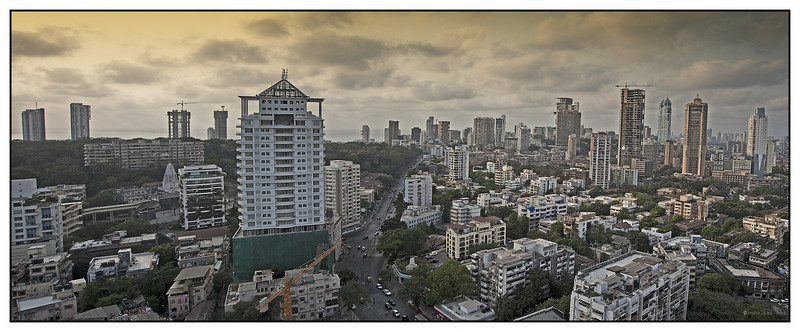 "3rd year Pic 215 - Apr 26 2011<br /> Bird's eye view of Mumbai<br /> Shot from 20th floor terrace of Sarathi building<br /> <br /> <br /> Best seen in Origial size. <br /> 3 images pano shot with D700 ISO 200 f9 1/160<br /> The building between the green covering and the crane is where I stay.<br /> <br /> <br /> Another version is here: <br /> <a href=""http://hershy.smugmug.com/Photography/Mumbai-my-city/Misc-shots-of-Mumbai/6410100_x8urE#1269754910_XPjkpMJ-A-LB"">http://hershy.smugmug.com/Photography/Mumbai-my-city/Misc-shots-of-Mumbai/6410100_x8urE#1269754910_XPjkpMJ-A-LB</a>"