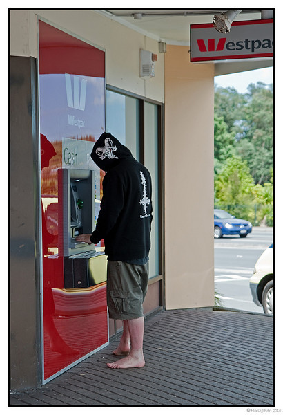 "3rd year Pic 254 - Jun15 2011 <span style=""color:yellow"">Shopping list  #1 SANDALS</span>   This was shot in a small town where we had stopped for coffee. In an earlier pic I had mentioned that in New Zealand many people roamed around barefoot.  The sight of the barefoot hooded man was too good a photo-op to miss! <br> http://hershy.smugmug.com/Photography/Daily-third-year/12987576_NS8Rf#1240724723_SdmZy-A-LB<br> <span style=""color:cyan"">For more pictures of Rotorua go to  </span> <br> http://hershy.smugmug.com/Travel/New-Zealand-Macau-Hong-Kong/Rotorua/15128440_rKfDQ<br>  It was a pleasant surprise to wake up and see my yesterday's pic On way To Rotorua in the first place at the Daily gallery. Thank you all for your comments!"