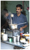 """3rd year Pic 040 - Aug 31 2010<br /> Tea stall, Dhobi Ghat<br /> <br /> @ Andrea: The man is stirring and making a froth with a ladel. <br /> <br /> B&W version:   <br />  <a href=""""http://hershy.smugmug.com/Photography/Mumbai-my-city/Dhobi-ghat-cuffe-Parade/10119943_4urML#984113202_rbnGG-A-LB"""">http://hershy.smugmug.com/Photography/Mumbai-my-city/Dhobi-ghat-cuffe-Parade/10119943_4urML#984113202_rbnGG-A-LB</a><br /> <br /> LFI news! One more pic selected for D-Lux Master Shot  <br />  <a href=""""http://gallery.lfi-online.de/gallery/displayimage.php?album=lastup&cat=-2776&pos=3"""">http://gallery.lfi-online.de/gallery/displayimage.php?album=lastup&cat=-2776&pos=3</a><br /> <br /> THANK YOU all for your comments on yesterday's pic of the tailor."""